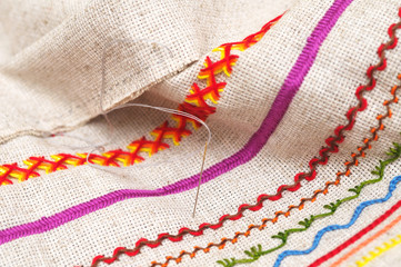 needle on fabric with embroidery