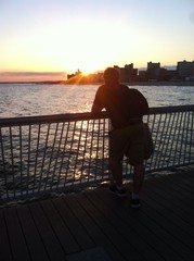 man at sunset on Coney Island