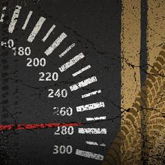 Speedometer on the old asphalt road
