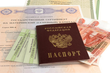 Russian passport with money and maternal, birth and pension cert
