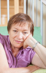 Thoughtful mature woman with sad face