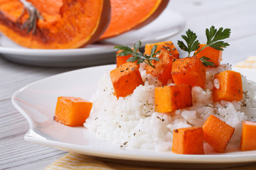 Risotto with pumpkin close-up on a plate.