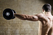 Man lifting weights with shoulders training at old gym - 72396386