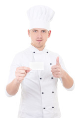 young man chef  in uniform thumbs up and showing blank visiting