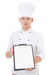 young handsome man in chef uniform showing clipboard with blank
