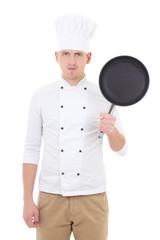 young handsome man chef in uniform with teflon frying pan isolat