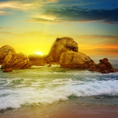 sea landscape with rocky island and the sunrise