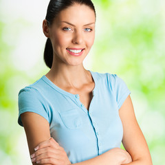 Portrait of young smiling woman, outdoor