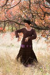 young beautiful woman dancing ritual dance mandala