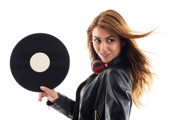Portrait of a young woman holding a vinyl record against white b