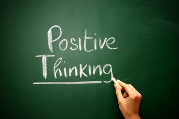 Word positive thinking drawn on a chalkboard,business concept