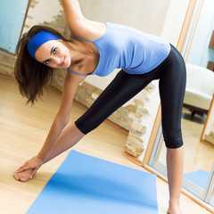 Happy smiling woman exercising at home