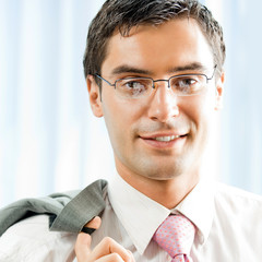 Portrait of young successful businessman at office
