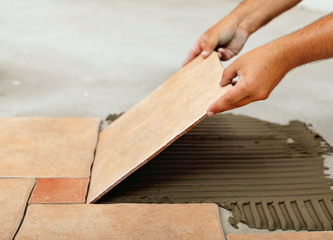 Phases of installing ceramic floor tiles - placing the tile