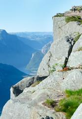 Family on  Preikestolen massive cliff top (Norway)