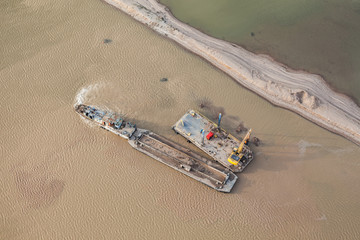 sand dredger on barge on Nysa lake in poland