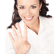 Businesswoman showing four fingers, on white