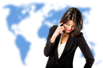 executive woman talking on the phone over world map