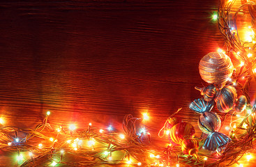 Christmas garlands of lamps on a wooden background.