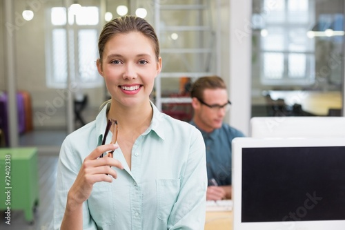 canvas print picture Smiling female photo editor in office