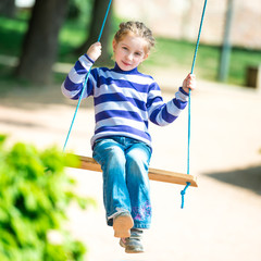 little girl on swing