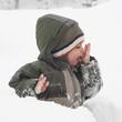 Child in snow in winter