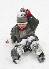 Child in snow in winter