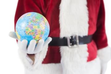 Santa has a globe in his hand