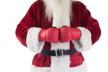 Santa Claus wears boxing gloves