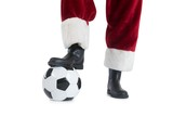 Santa Claus is playing soccer