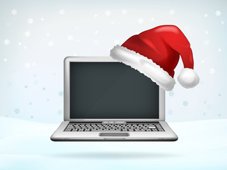 blank screen of laptop covered with Santa cap