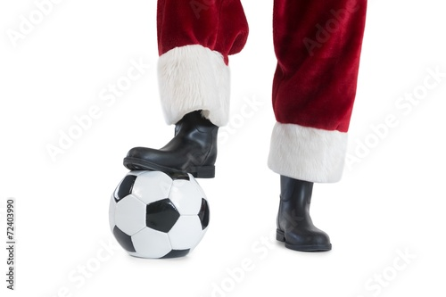 Santa Claus is playing soccer - 72403990