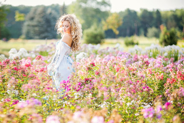 beautiful young girl in a garden of flowers