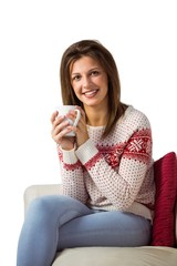 Woman sitting on the couch holding mug of coffee
