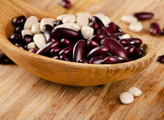 Red and white Kidney beans on  a wooden background