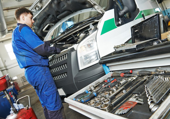 repairman servicing auto car