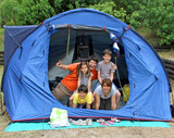 happy family of five in the tent camping