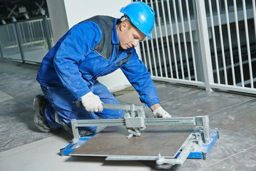tiler working with tile cutting equipment