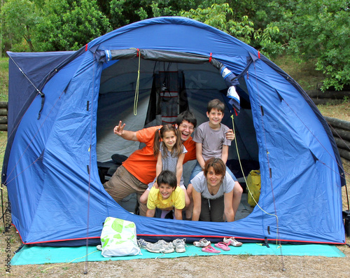Leinwandbild Motiv happy family of five in the tent camping