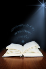 Old open book with magic wi-fi