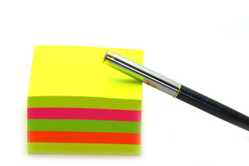 Stack of post its and a pen