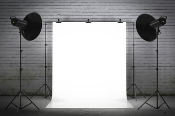 Professional strobe lights illuminating a backdrop