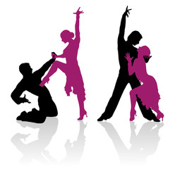 Silhouettes of couple dancing ballroom dance