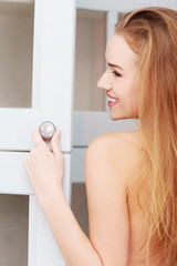 Woman opening wardrobe doors