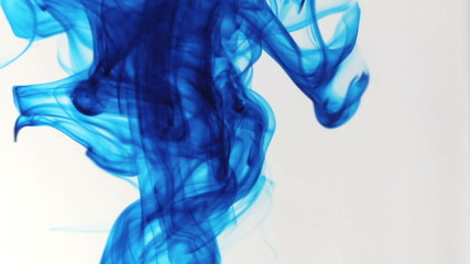 Colored ink cloud grows in water