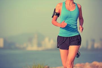 woman runner athlete running at seaside