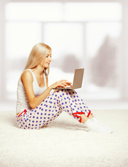 Blonde woman with laptop