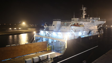 ferry in seaport at night