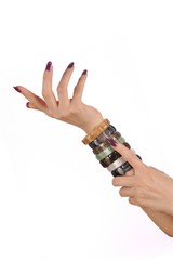 Beautiful woman hands with gemstone bracelets