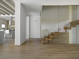 foreground on the wood staircase in a modern living room